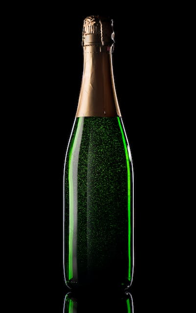 Green bottle of champagne