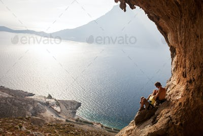 Young couple of rock climbers having a rest