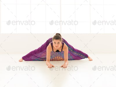demonstration of stretching yoga pose