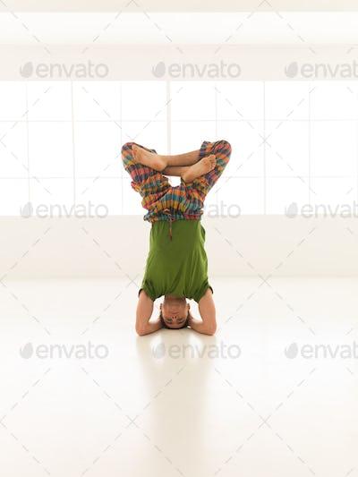head sitting cross-legged