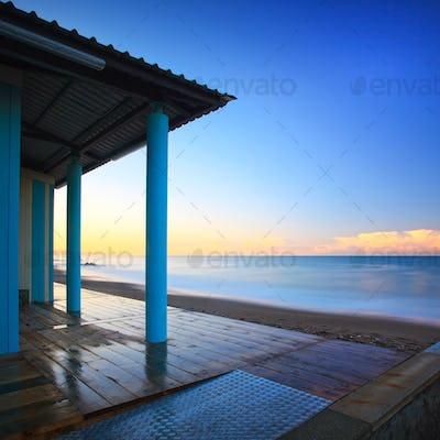Beach bathhouse colonnade architecture, sea on morning. Tuscany