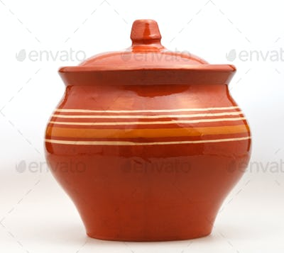 closed earthenware pot on white