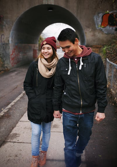 Loving young couple walking on a street