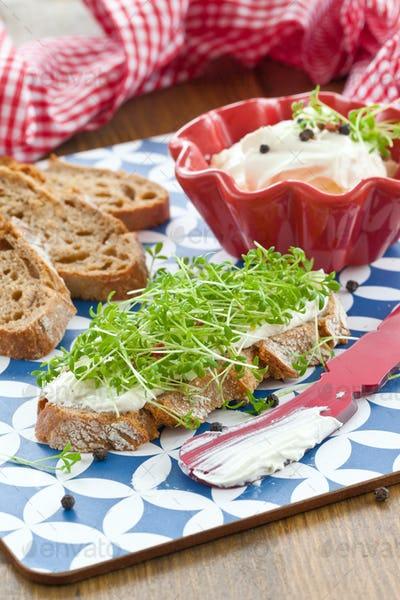 Fresh bread, cream cheese and cress