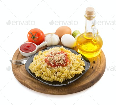 pasta fusilli in plate on white