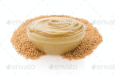 mustard sauce in bowl on white