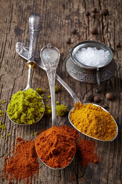 various spices on a dark background