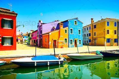 Venice landmark, Burano island canal, colorful houses and boats,