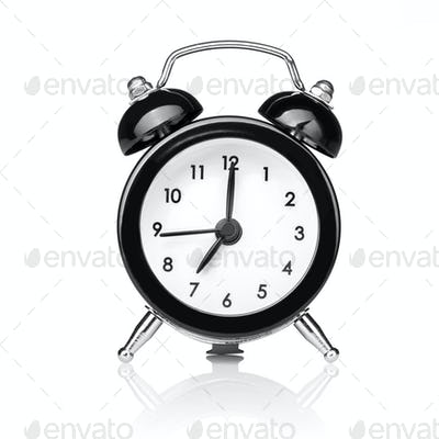 Black old style alarm clock isolated on white