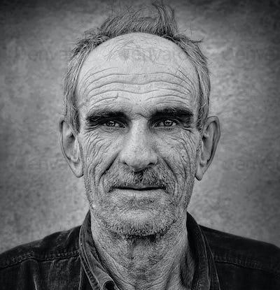 Artistic old photo of elderly bald man, grunge vintage backgroun