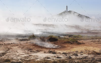 Geothermal area in Iceland with lighthouse.