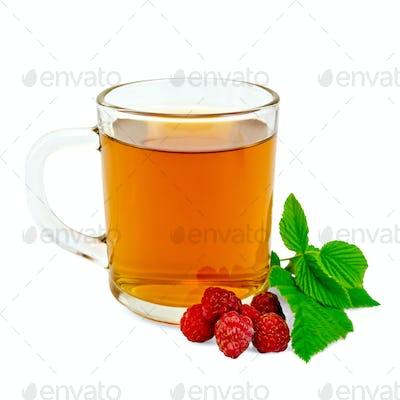 Tea with raspberry in glass mug