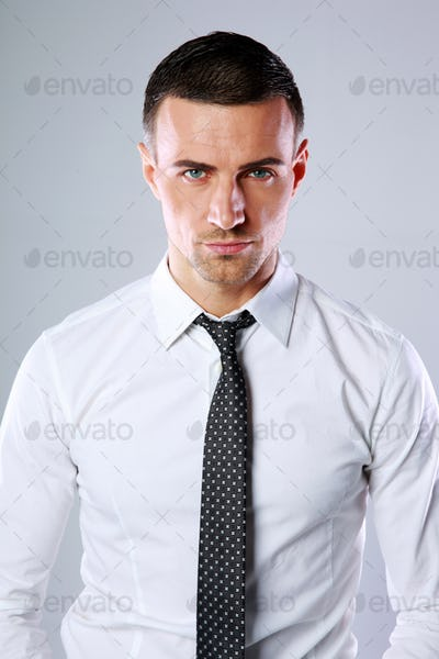 Portrait of a confident man over gray background