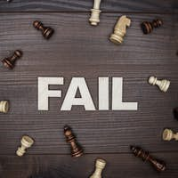 Fail Concept On Wooden Background