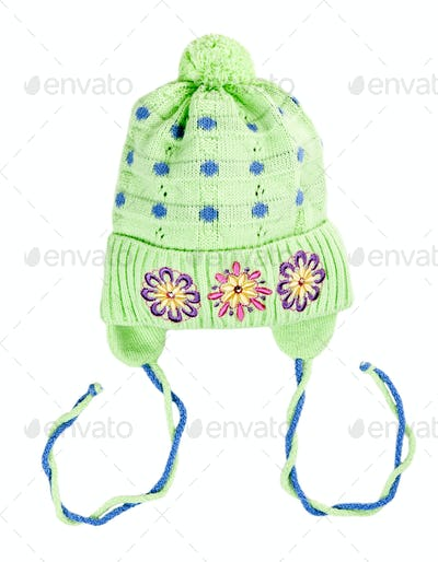 green baby knitted hat with a flower pattern