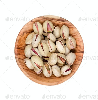 Pistachios in a wooden bowl