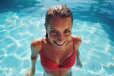Female in bikini smiling at camera looking funny