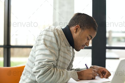 Man taking notes for his study