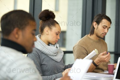 Woman studying hard for exams in library