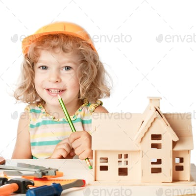Happy child builds house