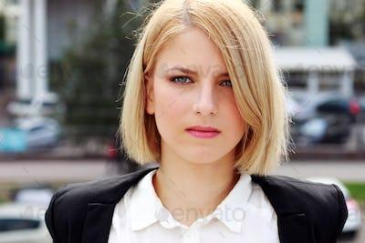 Closeup portrait of a pensive woman