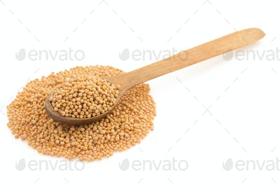 mustard spices in spoon on white