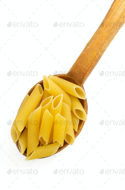 pasta Penne in spoon on white