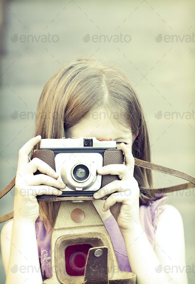 Little girl taking picture