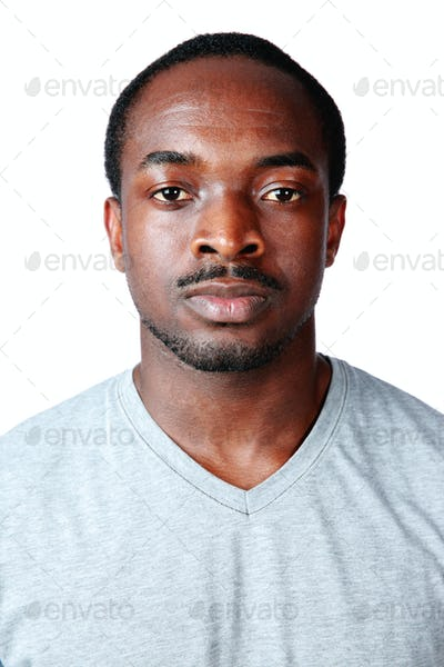 Portrait of a serious african man isolated on white background
