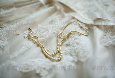 wedding dress detail with pearls