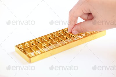 golden abacus and a hand