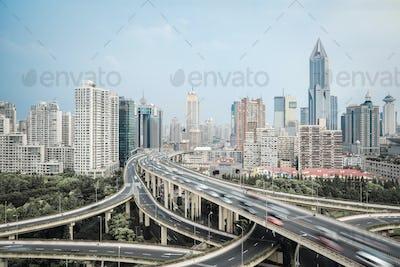 modern city skyline with interchange overpass