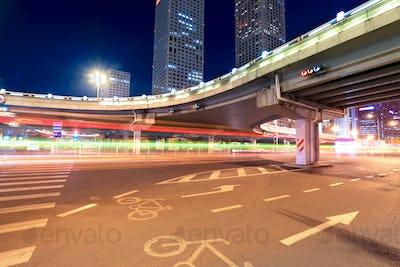 light trails on the beijing international trade bridge