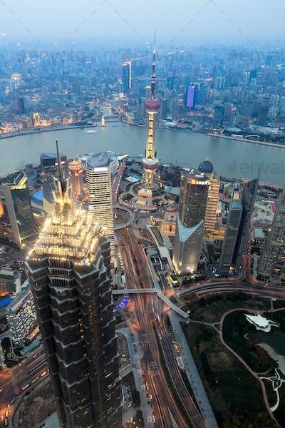 overlooking shanghai financial center at dusk