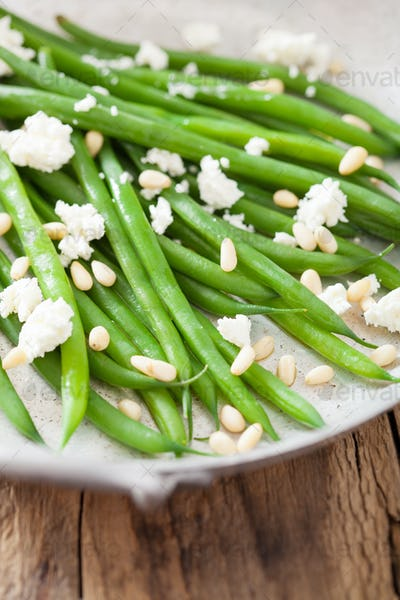 green beans with goat cheese and pine nuts