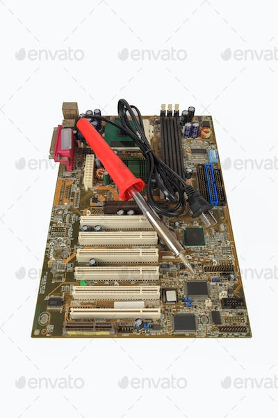 soldering iron and computer motherboard