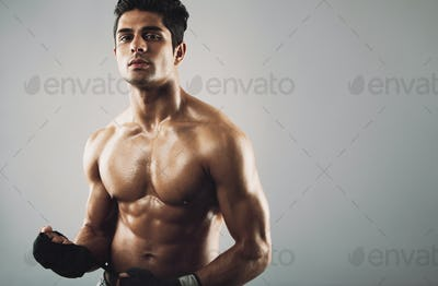 Hispanic male athlete with muscular physique
