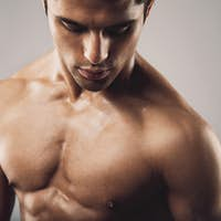 Portrait of fit masculine man looking down