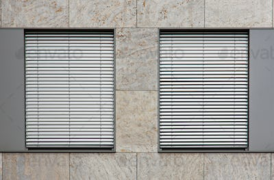 Two windows with shutters