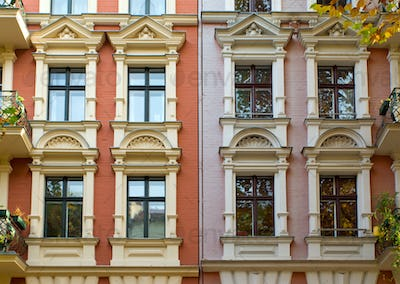 Windows of two rehabilitated townhouses