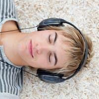 Teen guy listening to music