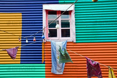 Colourful window with laundry in La Boca