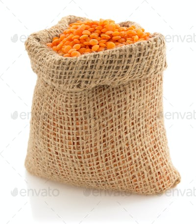 lentil in sack bag on white