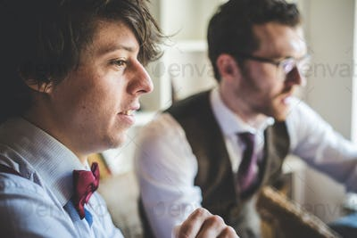 two young hipster stylish men working