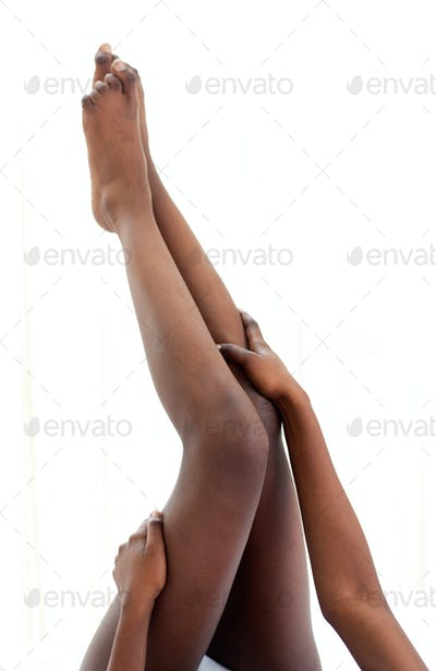 Afro-American woman lying on her bed