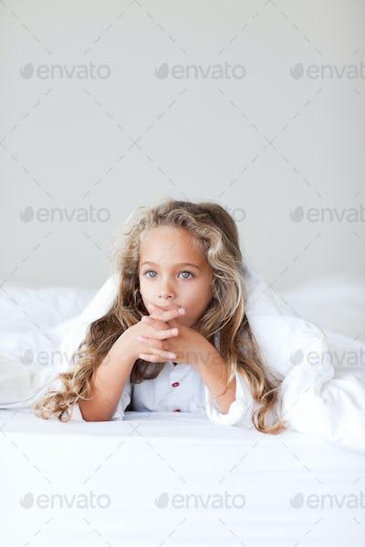 Lovely girl on her bed
