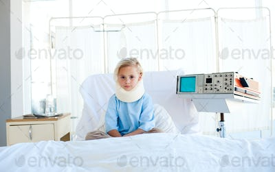 Upset patient with a neck brace sitting on a hospital bed