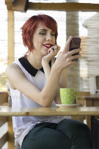 Cute hipster girl texting