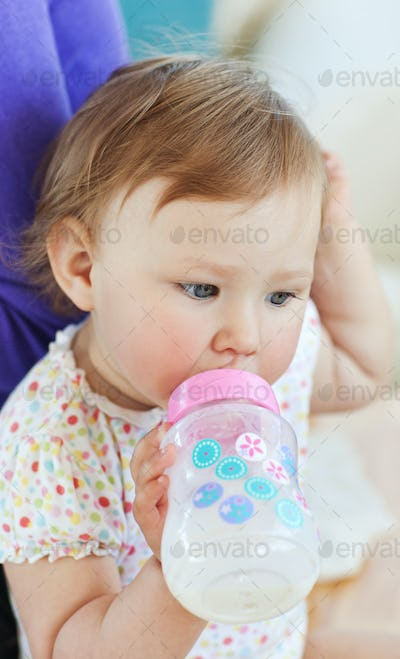 Young girl drinking