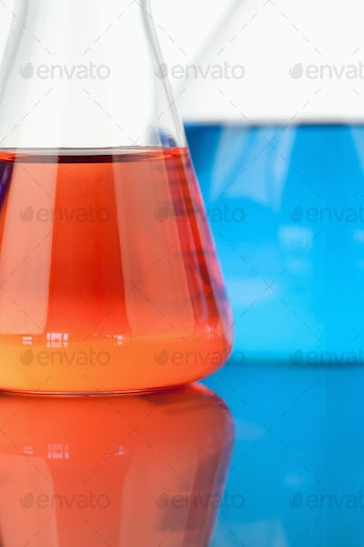 Blue and red beakers